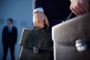 Bankruptcy Lawyer Holding a Briefcase